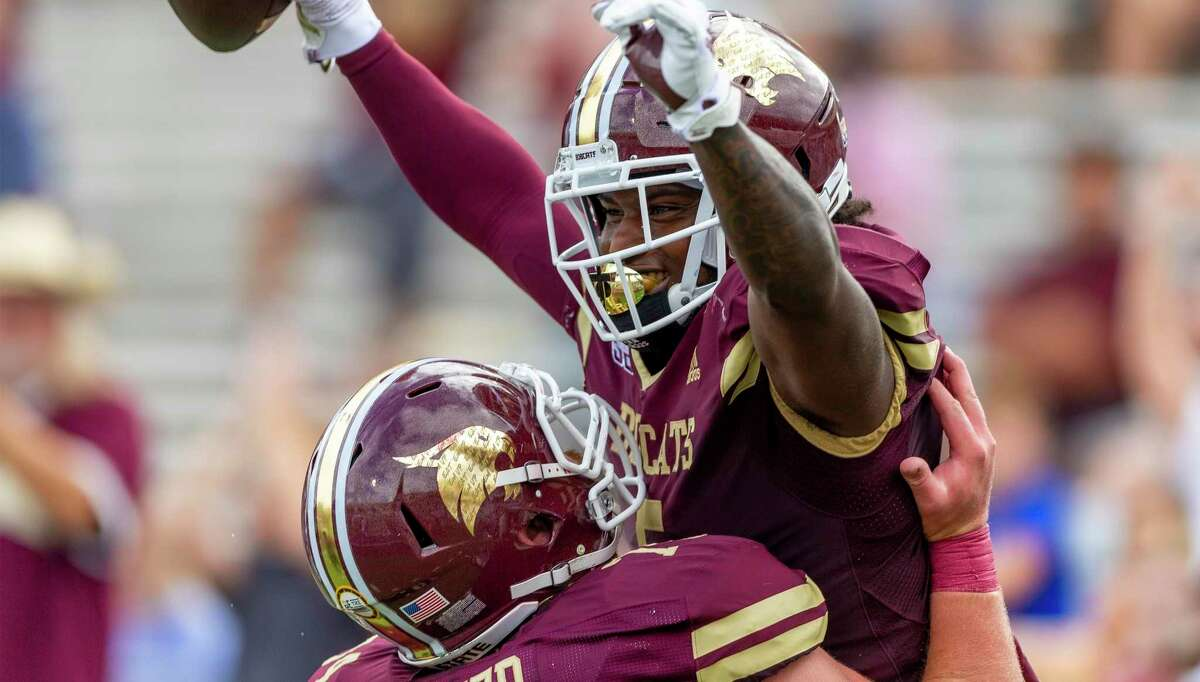 Texas State running back Brock Sturges (5) celebrates his touchdown against Southern Methodist with offensive lineman Russell Baker (74) during an NCAA football game on Saturday, Sept. 5, 2020 in San Marcos, Texas. (AP Photo/Stephen Spillman)