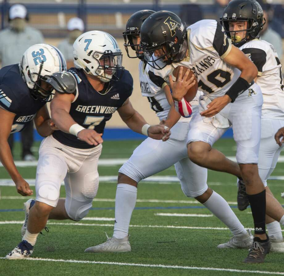 Andrews' E.J. Lopez tries to make more yards as Greenwood's Drew Crunk chases 09/11/2020 at Grande Communications Stadium. Tim Fischer/Reporter-Telegram Photo: Tim Fischer/Midland Reporter-Telegram