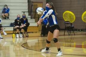 Gladwin's Taylor Vasher bumps the ball during a match against Beaverton Friday, Sept. 11, 2020 at Beaverton High School. (Katy Kildee/kkildee@mdn.net)