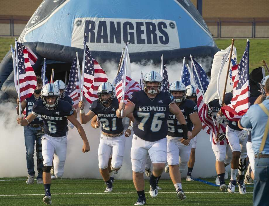 Greenwood players carry American Flags and armed services flags as they take the field 09/11/2020 at Grande Communications Stadium. Tim Fischer/Reporter-Telegram Photo: Tim Fischer/Midland Reporter-Telegram