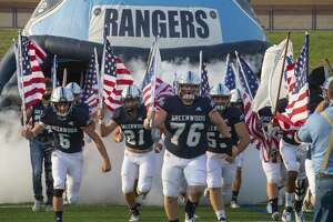Greenwood players carry American Flags and armed services flags as they take the field 09/11/2020 at Grande Communications Stadium. Tim Fischer/Reporter-Telegram