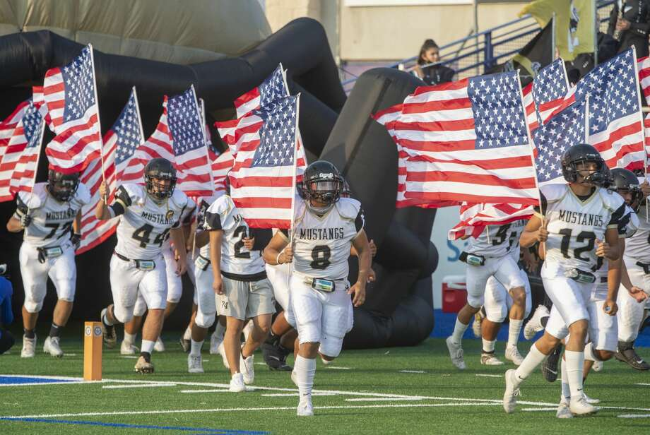 Andrews players carry American Flags as they take the field 09/11/2020 at Grande Communications Stadium. Tim Fischer/Reporter-Telegram Photo: Tim Fischer/Midland Reporter-Telegram