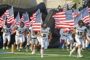 Andrews players carry American Flags as they take the field 09/11/2020 at Grande Communications Stadium. Tim Fischer/Reporter-Telegram