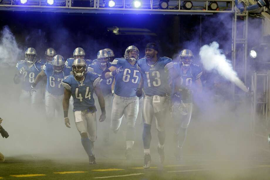 The Detroit Lions runs out before the start of the first quarter of an NFL football game against the Minnesota Vikings in Detroit, Sunday, Jan. 2, 2011. (AP Photo/Carlos Osorio) Photo: Carlos Osorio/ASSOCIATED PRESS / AP2011
