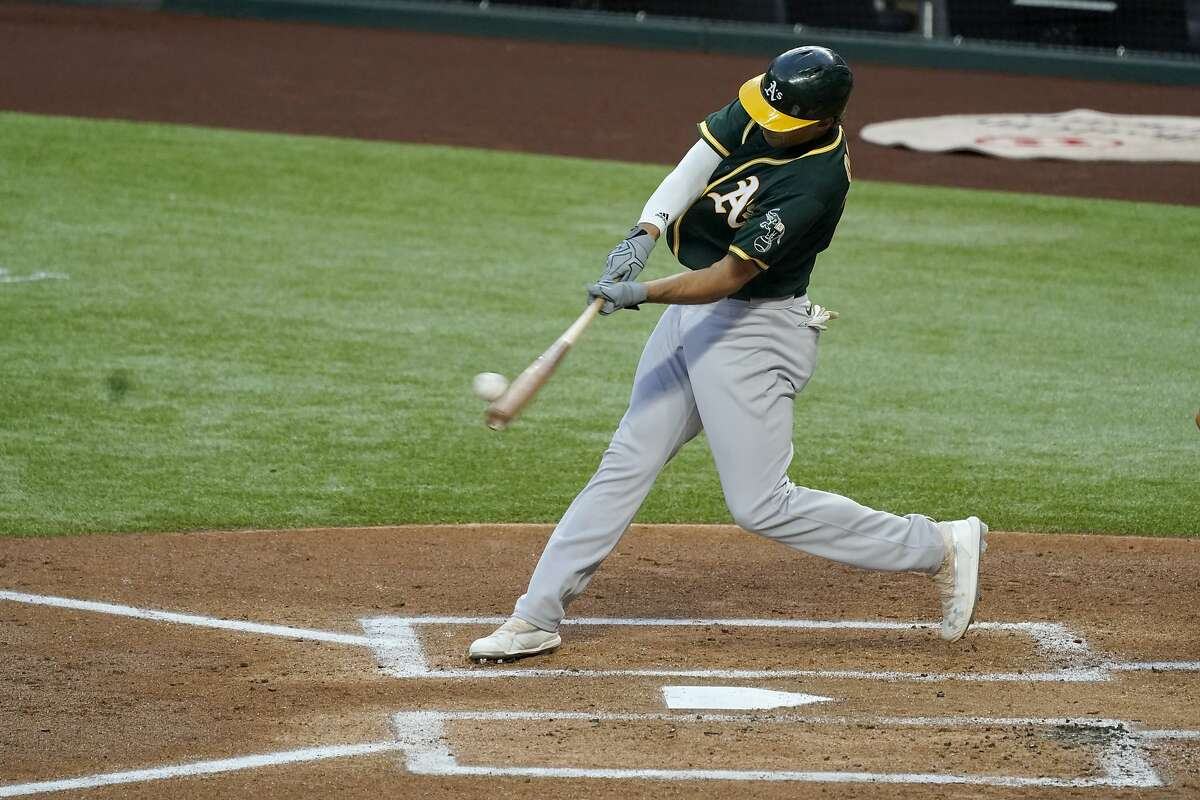 Oakland Athletics' Matt Olson connects on a pitch from Texas Rangers' Luis Garcia for a grand slam in the first inning of a baseball game in Arlington, Texas, Friday, Sept. 11, 2020. (AP Photo/Tony Gutierrez)