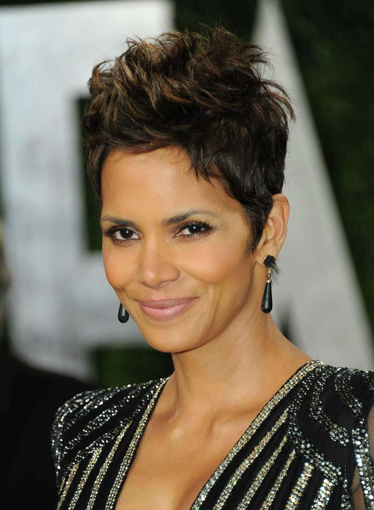 Actress Halle Berry arrives at the 2013 Vanity Fair Oscar party on Sunday, Feb. 24 2013 at the Sunset Plaza Hotel in West Hollywood, Calif. (Photo by Jordan Strauss/Invision/AP)