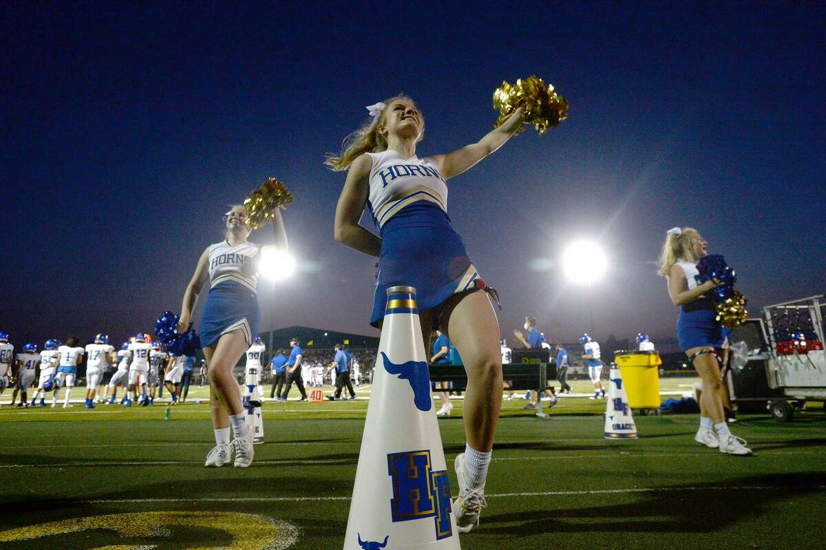 Hamshire-Fannett's cheerleaders keep the spirit alive as they battle East Chambers during their match for the Rice Bowl win Friday night in Winnie. Photo taken Friday, September 11, 2020 Kim Brent/The Enterprise