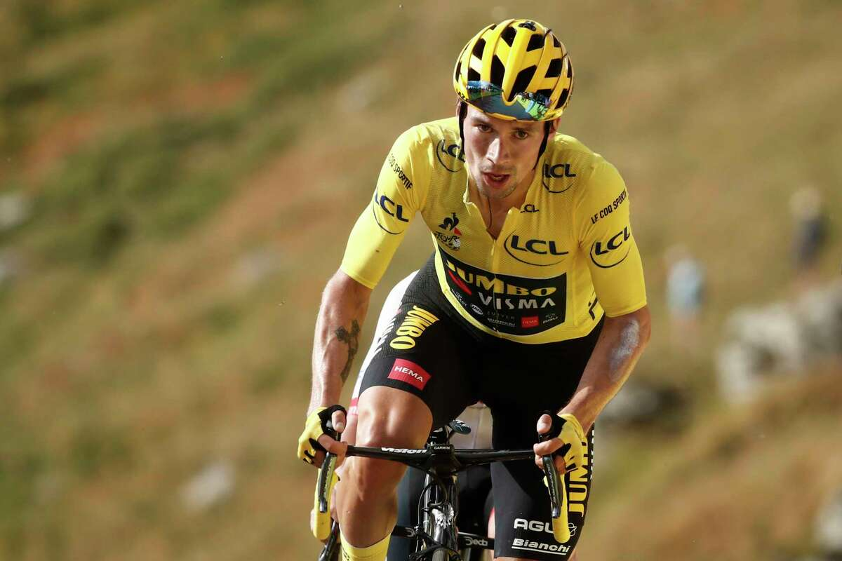 Slovenia's Primoz Roglic wearing the overall leader's yellow jersey crosses the finish line of the stage 13 of the Tour de France cycling race over 191 kilometers from Chatel-Guyon to Puy Mary, Friday, Sept. 11, 2020. (Benoit Tessier, Pool via AP)