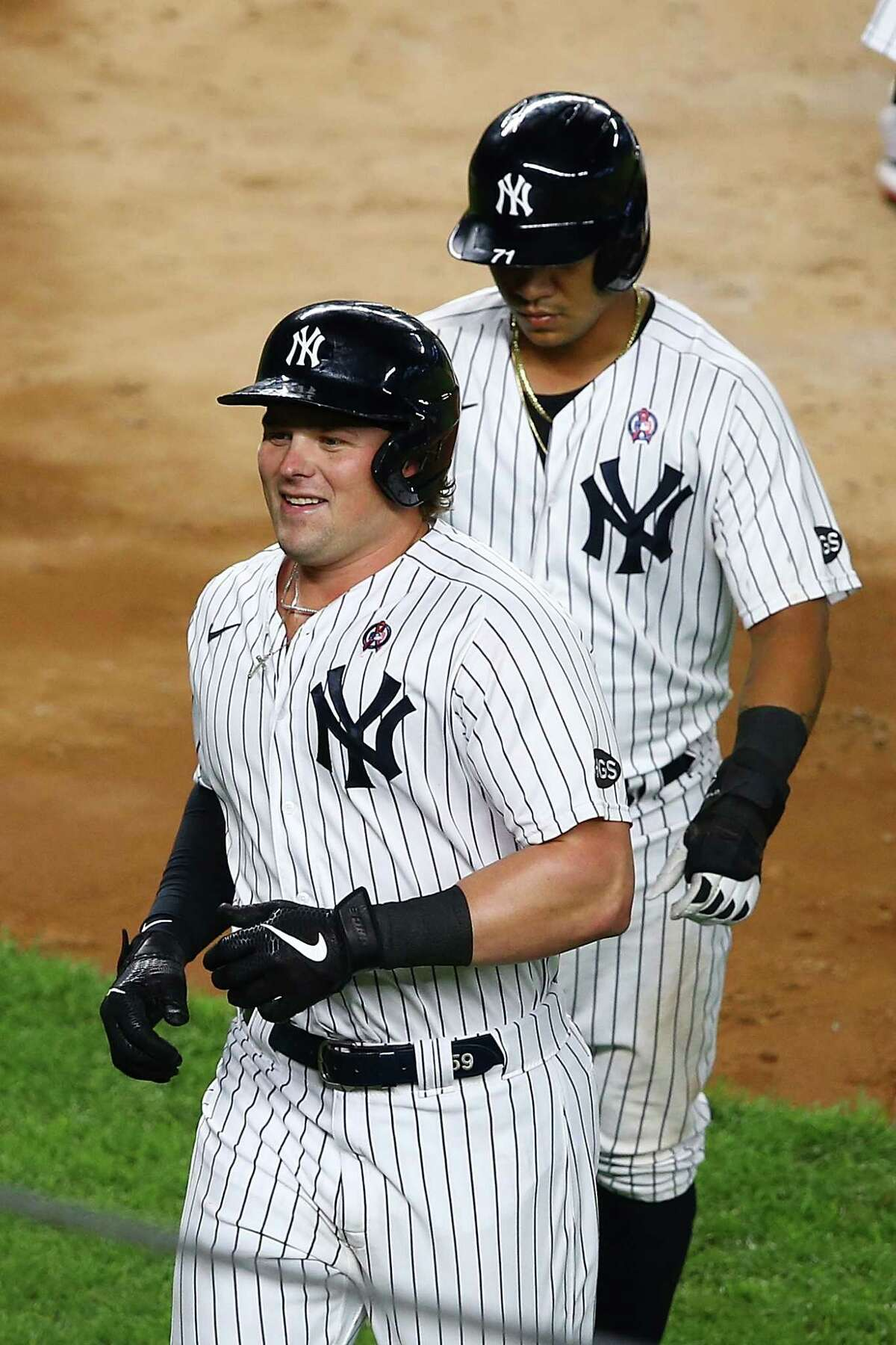 NEW YORK, NEW YORK - SEPTEMBER 11: Luke Voit #59 of the New York Yankees smiles after hitting a 3-run home run to center field in the fourth inning against the Baltimore Orioles at Yankee Stadium on September 11, 2020 in New York City. (Photo by Mike Stobe/Getty Images)