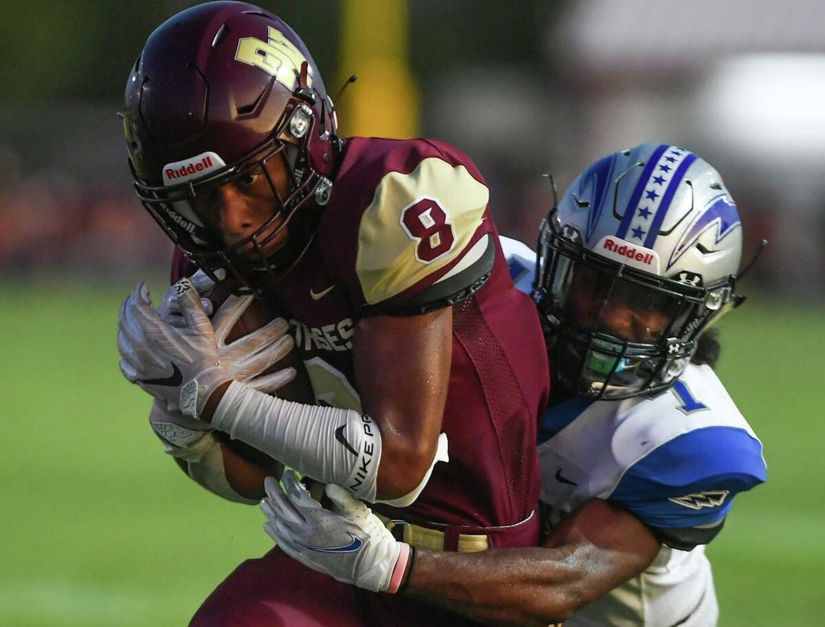 Wide receiver Mason Burford of Devine runs for yardage as defender Deiondre Holmes of Randolph brings him down during high school football action at Warhorse Stadium on Friday, Sept. 11, 2020.
