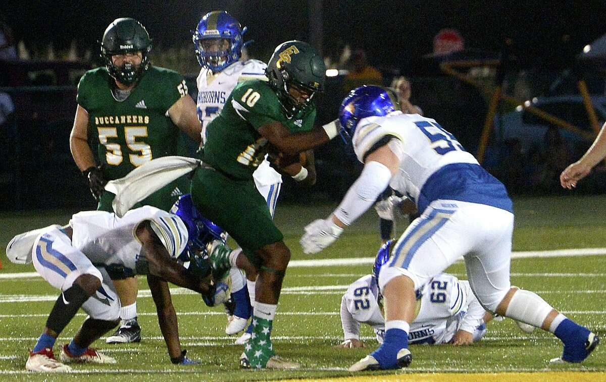 East Chambers' Jacoby P{errault runs the ball against Hamshire-Fannett's defense during their match for the Rice Bowl win Friday night in Winnie. Photo taken Friday, September 11, 2020 Kim Brent/The Enterprise