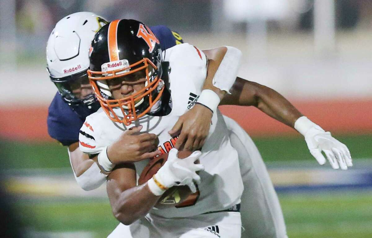 Poth's Matthew Bunn wraps up Karnes City's Jaden Jamarillo during their high school football game at Poth on Friday, Sept. 11, 2020.