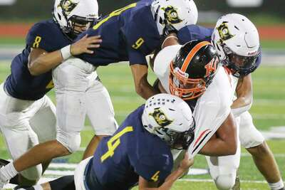 Karnes City's Christian Jimenez gets taken down by Poth defenders Cooper Conn (4), Tristan Trevino (8), Seth Dryzmala (9) and Matthew Bunn (28) during their high school football game at Poth on Friday, Sept. 11, 2020.