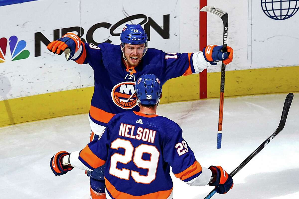 EDMONTON, ALBERTA - SEPTEMBER 11: Anthony Beauvillier #18 of the New York Islanders is congratulated by Brock Nelson #29 after scoring a goal against the Tampa Bay Lightning during the second period in Game Three of the Eastern Conference Final during the 2020 NHL Stanley Cup Playoffs at Rogers Place on September 11, 2020 in Edmonton, Alberta, Canada. (Photo by Bruce Bennett/Getty Images)
