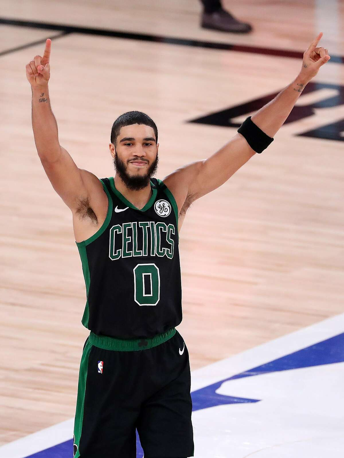 LAKE BUENA VISTA, FLORIDA - SEPTEMBER 11: Jayson Tatum #0 of the Boston Celtics reacts after their win against the Toronto Raptors in Game Seven of the Eastern Conference Second Round during the 2020 NBA Playoffs at AdventHealth Arena at the ESPN Wide World Of Sports Complex on September 11, 2020 in Lake Buena Vista, Florida. NOTE TO USER: User expressly acknowledges and agrees that, by downloading and or using this photograph, User is consenting to the terms and conditions of the Getty Images License Agreement. (Photo by Michael Reaves/Getty Images)