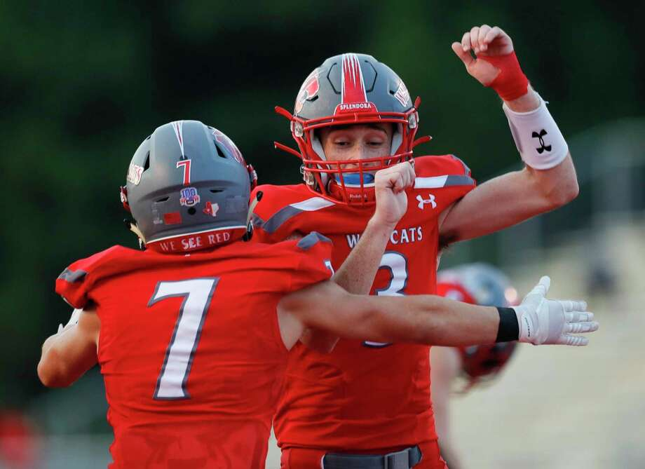 Splendora wide receiver Nick Johnson (7) celebrates with quarterback Jagger Kennedy (5) after connecting on a 5-yard touchdown pass during the first quarter of a non-district high school football game at Wildcat Stadium, Friday, Sept. 11, 2020, in Splendora. Photo: Jason Fochtman, Houston Chronicle / Staff Photographer / 2020 © Houston Chronicle