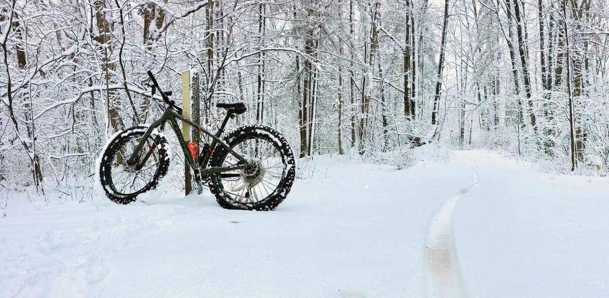 A fat tire bike sits ready for riding after a fresh Michigan snowfall. (MI DNR/Courtesy Photo)
