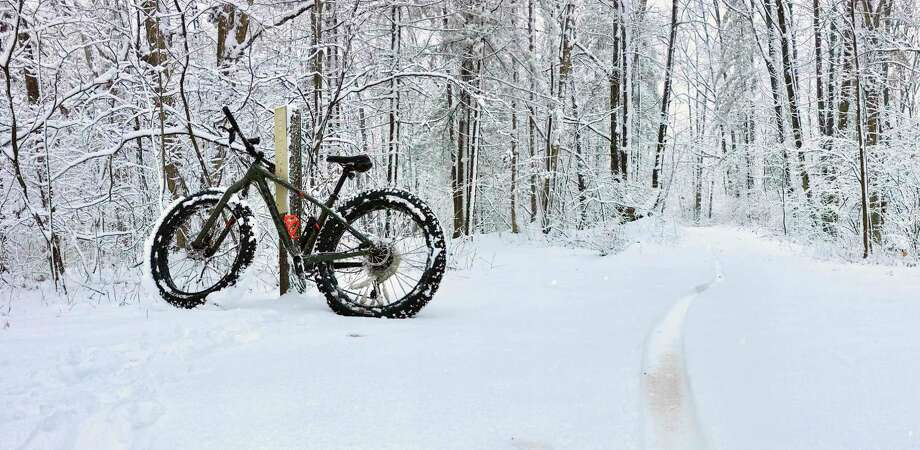 A fat tire bike sits ready for riding after a fresh Michigan snowfall. (MI DNR/Courtesy Photo)