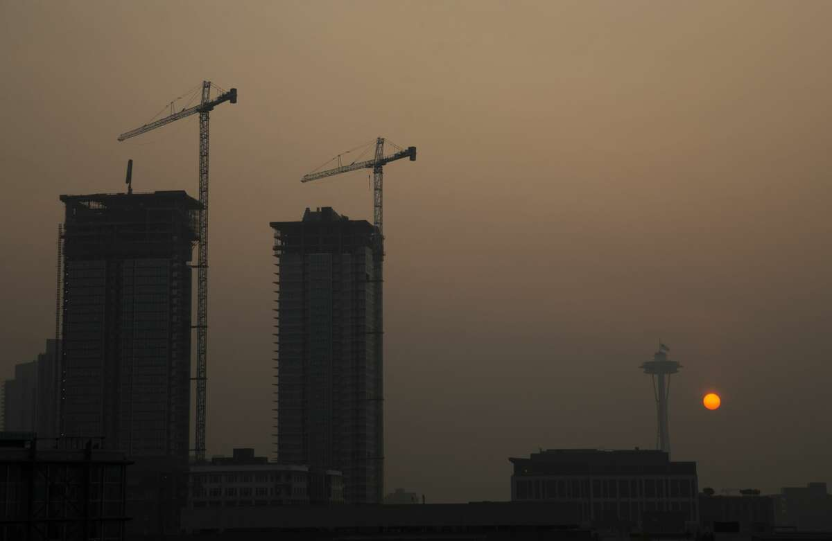 Cranes and the Space Needle are silhouetted in hazy smoke from wildfires as the sun sets on September 11, 2020 in Seattle, Washington.