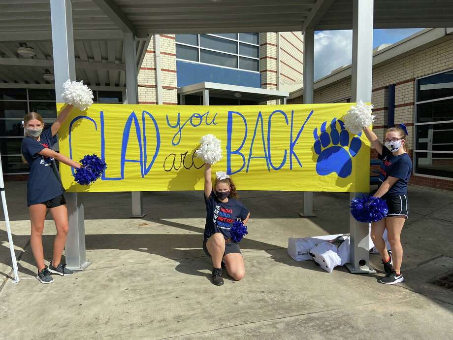 Cheer students pose next to a sign welcoming students back to Bear Branch Junior High School in Magnolia ISD, which began on-campus instruction Sept. 8, 2020. Photo: Courtesy Of Magnolia ISD / Submitted