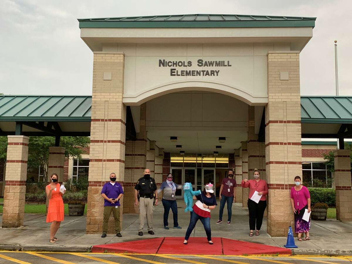 Staff members wait to welcome students back to Nichols Sawmill Elementary School in Magnolia ISD, which began on-campus instruction Sept. 8, 2020.