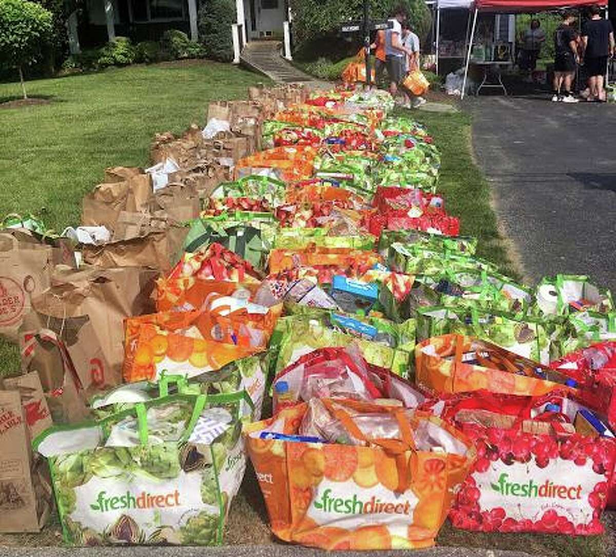 Groceries collected by the grassroots initiative Helping Families, a group of parents who stepped in to feed families of school children who received free and reduced meals in Stamford, Connecticut, in 2020.