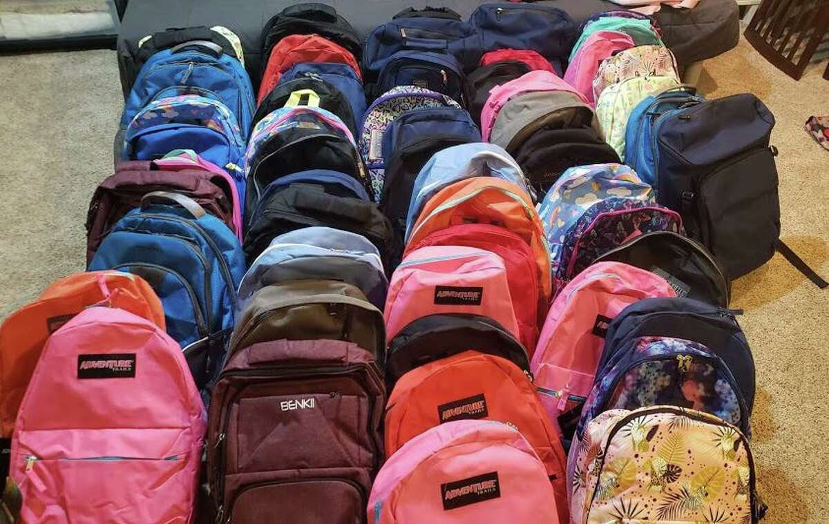 Backpacks filled by volunteers with Helping Families, a group of parents who stepped in to feed families of school children who previously received free and reduced meals in Stamford, Connecticut, in 2020.