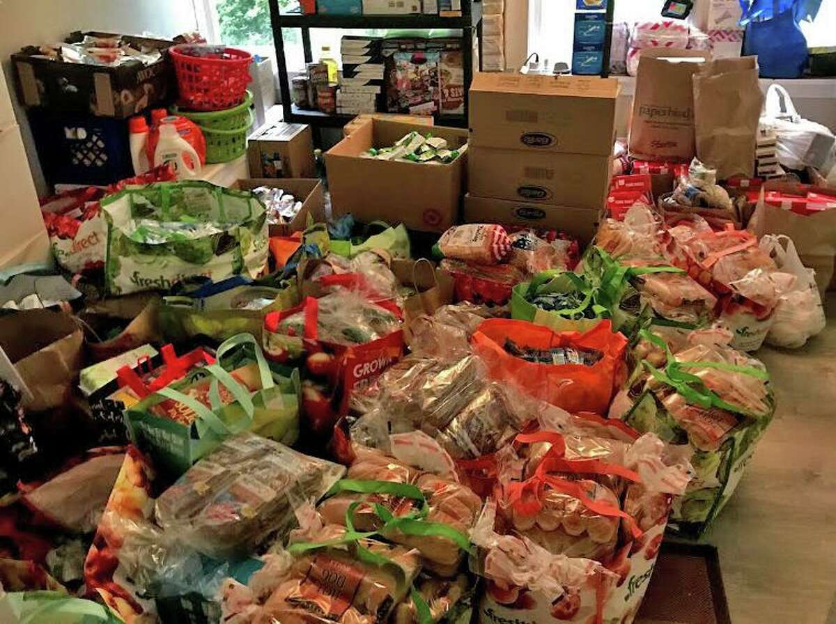 Volunteers with Helping Families turned rooms in their homes into stockrooms as part of the grassroots initiative to feed families of school children who previously received free and reduced meals in Stamford, Connecticut, in 2020.