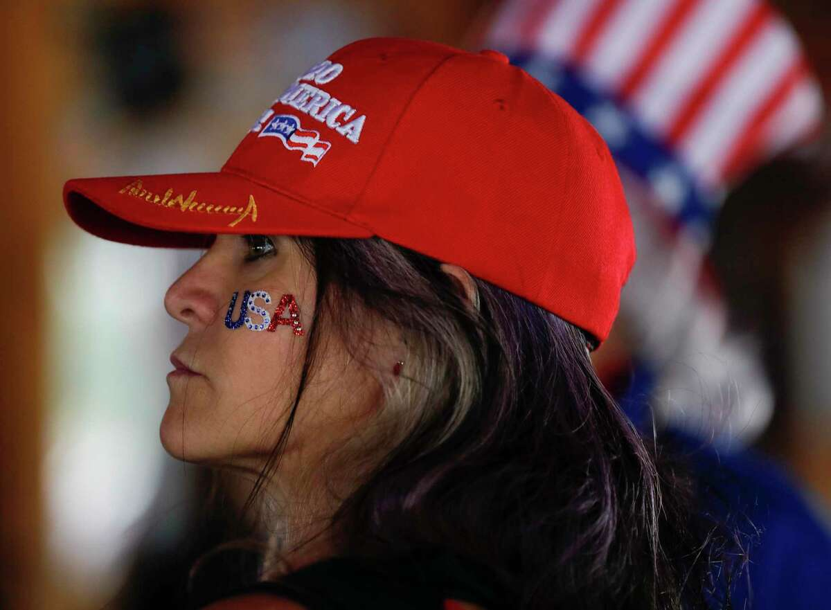 Carla Shouse turns out to support President Donald Trump during a May 16 boat parade on Lake Conroe.