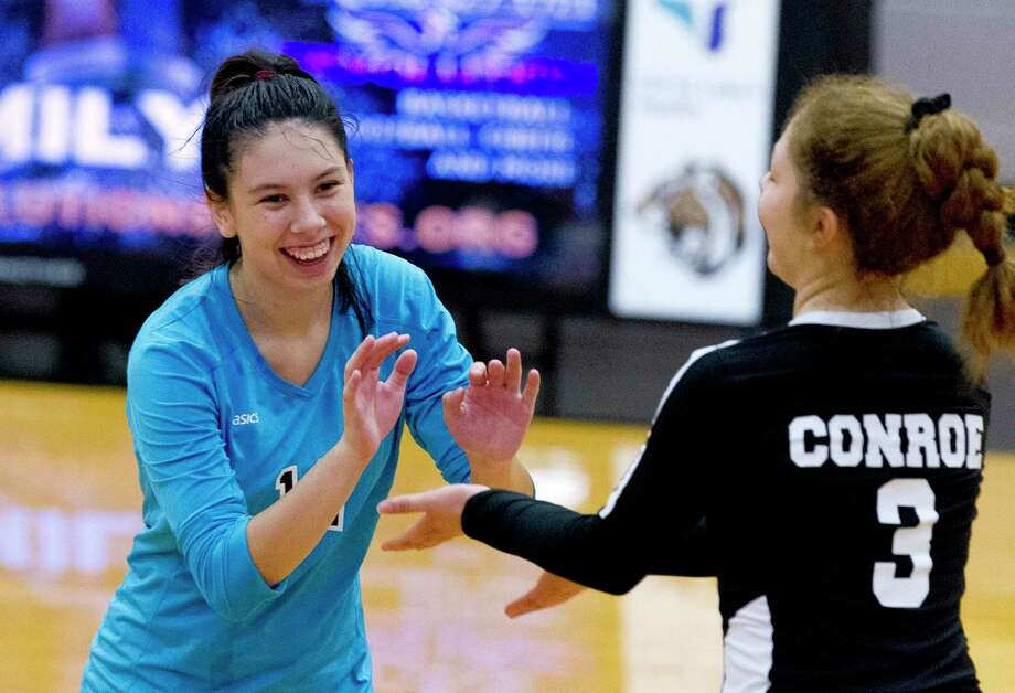 Conroe libero Saege Anzueto (12) shares a laugh with right side hitter Amanda Rivera (3) in the second set of a non-district high school volleyball match at Conroe High School, Tuesday, Aug. 13, 2019, in Conroe. Photo: Jason Fochtman, Houston Chronicle / Staff Photographer / Houston Chronicle