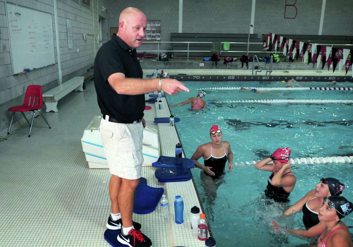 Branford girls swimming coach Scott Butler instructs his team during a practice at the Walsh Intermediate School pool in Branford in 2013.