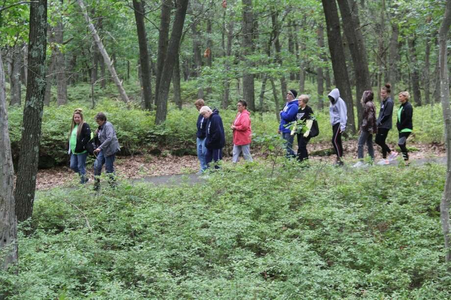 The 9th annual Walk for Awareness, put on my the Huron County Suicide Prevention Coalition, took place on Saturday morning at the Huron County Nature Center. About 50 people attended to partake in the walk through the Nature Center's woods. Photo: Robert Creenan/Huron Daily Tribune