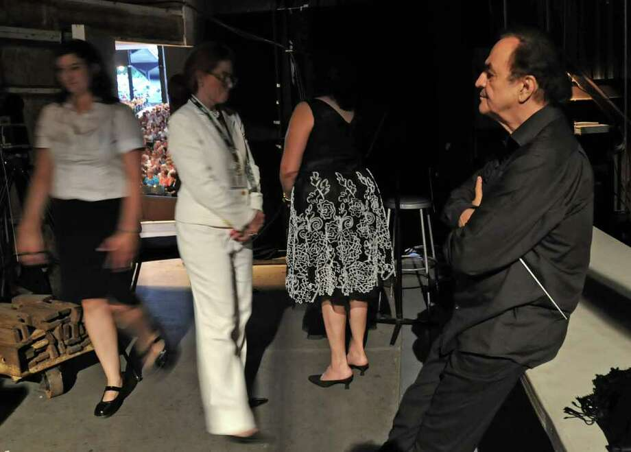 Conductor Charles Dutoit, right, waits backstage to be introduced during the  Philadelphia Orchestra's opening night at the Saratoga Performing Arts Center in Saratoga Springs, NY on August 4, 2010.  (Lori Van Buren / Times Union) Photo: LORI VAN BUREN