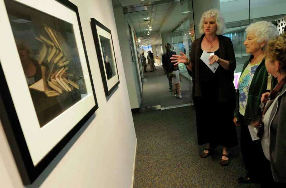 """Artist Fawn Potash talks about her work during the opening reception of the """"The Imaged Word"""" exhibition at the ?Albany International Airport gallery in Colnie,New York 7/23/2010. ( Michael P. Farrell / Times Union ) Photo: Michael P. Farrell"""