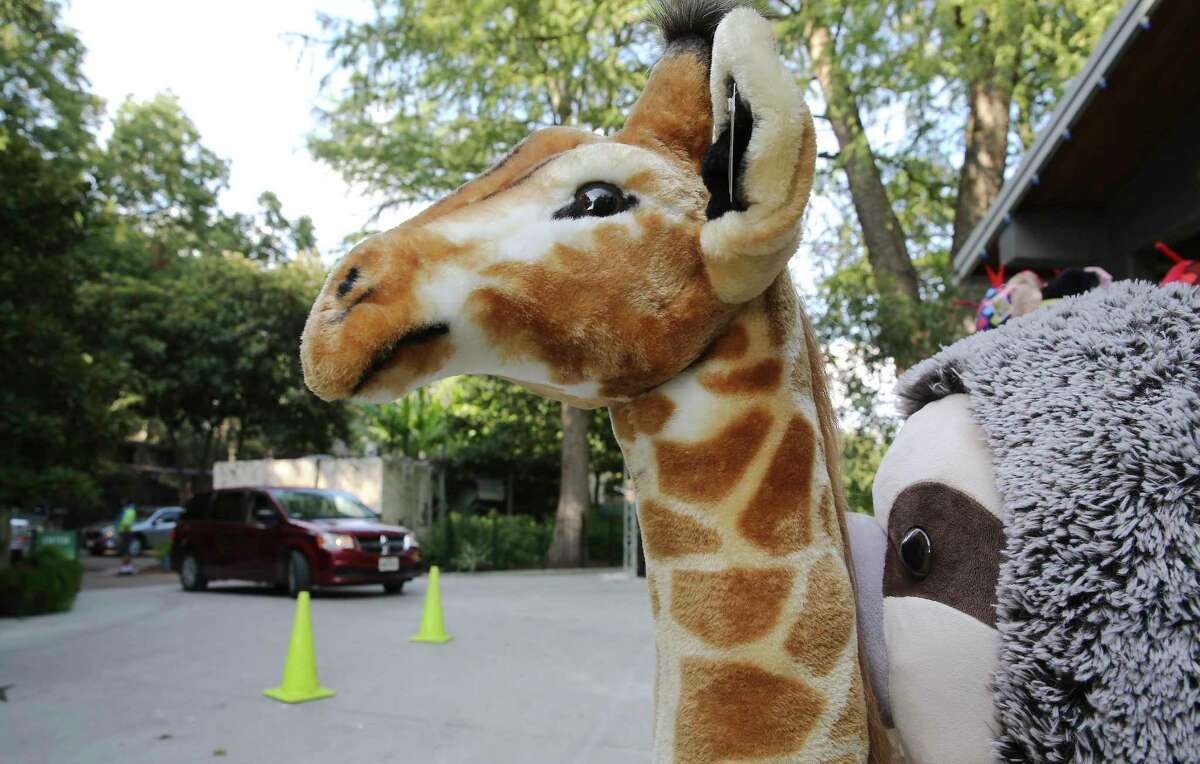 Stuffed animals are for sale as motorists conclude the drive-thru zoo experience. The Drive-Thru Zoo experience has turned out to be so popular that San Antonio zoo officials have decided to allow motorists to continue visiting the zoo in their own automobile permanently. Other zoos in Phoenix and Toronto are copying the experience.