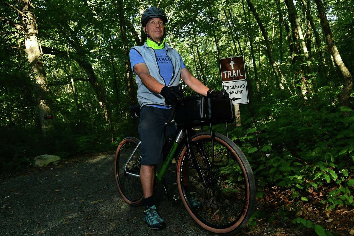 Mitch Ancona rides his bike 100 miles along a 2-mile loop of the Norwalk River Valley Trail as part of the The DIY DK 100 Mitch Ancona Ride to oraise money for the trail, Saturday, September 12, 2020, in Wilton, Conn.
