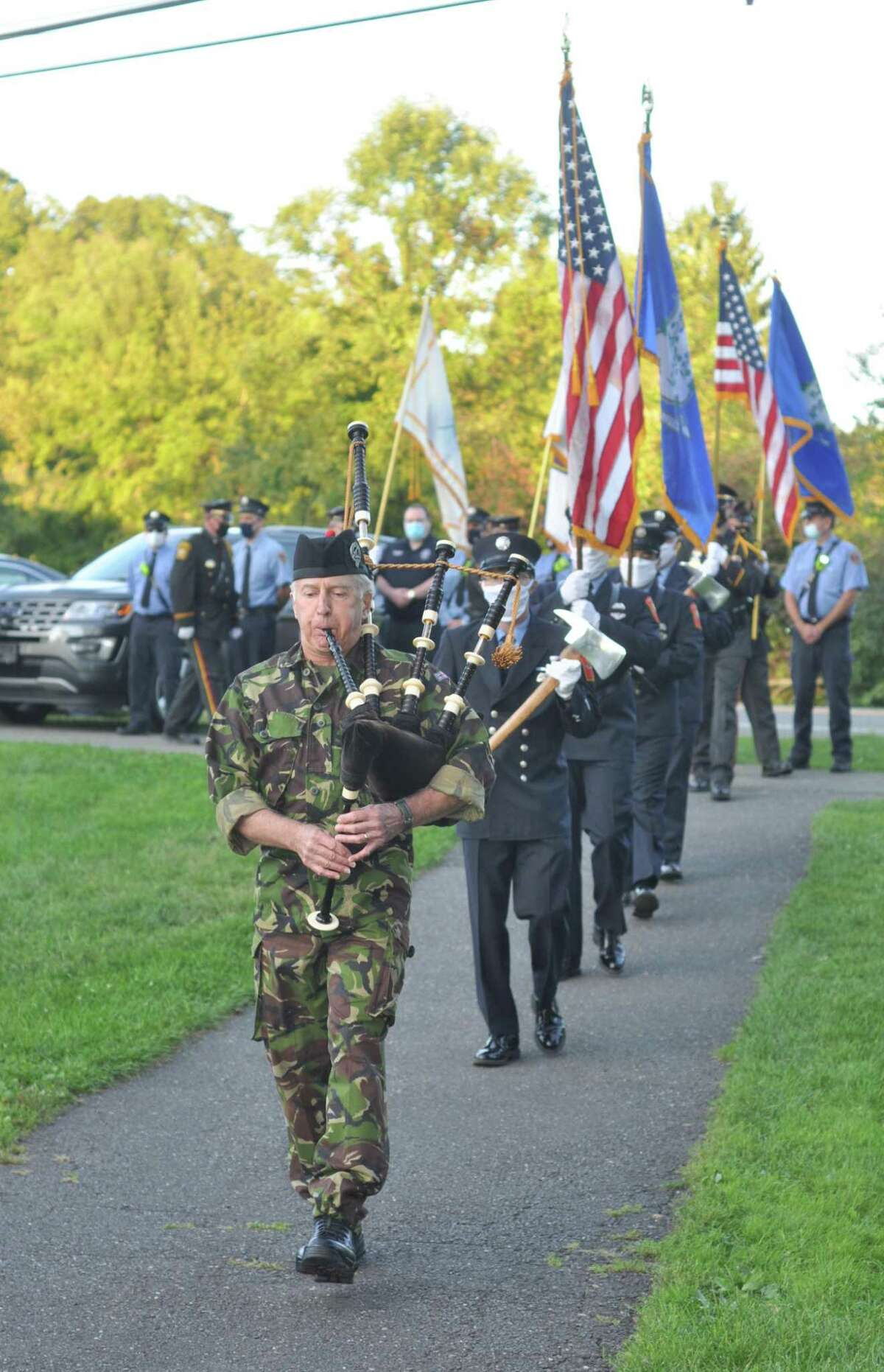 Piper Tom Elliott led in the color guard of Ridgefield firefighters and honor guard of Ridgefield police officers at the town's Sept. 11 ceremony for 2020 - the 19th year the event has been remembered with observance in town.