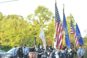 Piper Tom Elliott led in the color guard of Ridgefield firefighters and honor guard of Ridgefield police officers at the town's Sept. 11 ceremony for 2020 — the 19th year the event has been remembered with observance in town.
