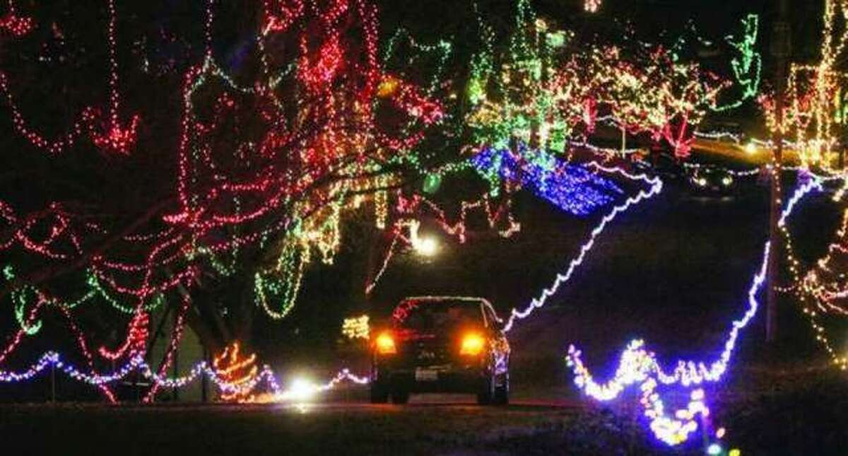 In this file photo, a lone vehicle drives through the annual Christmas Wonderland light display in Rock Spring Park. Although modified for this year, volunteers with the popular holiday attraction still plan to light up the park in an array of festive color in November and December.