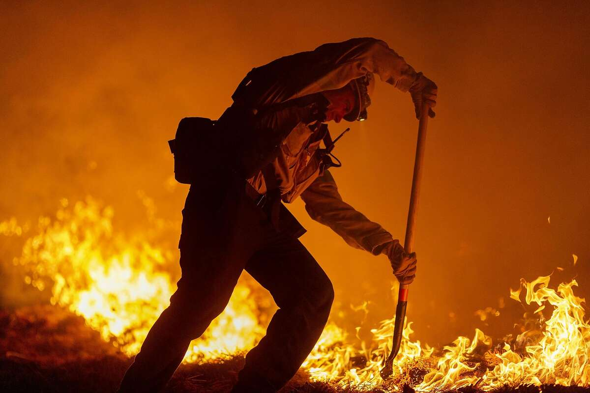 MONROVIA, CA - SEPTEMBER 11: Los Angeles County firefighters, using only hand tools, keep fire from jumping a fire break at the Bobcat Fire in the Angeles National Forest on September 11, 2020 north of Monrovia, California. California wildfires that have already incinerated a record 2.3 million acres this year and are expected to continue till December. The Bobcat Fire has grown to more than 26,000 acres. (Photo by David McNew/Getty Images)