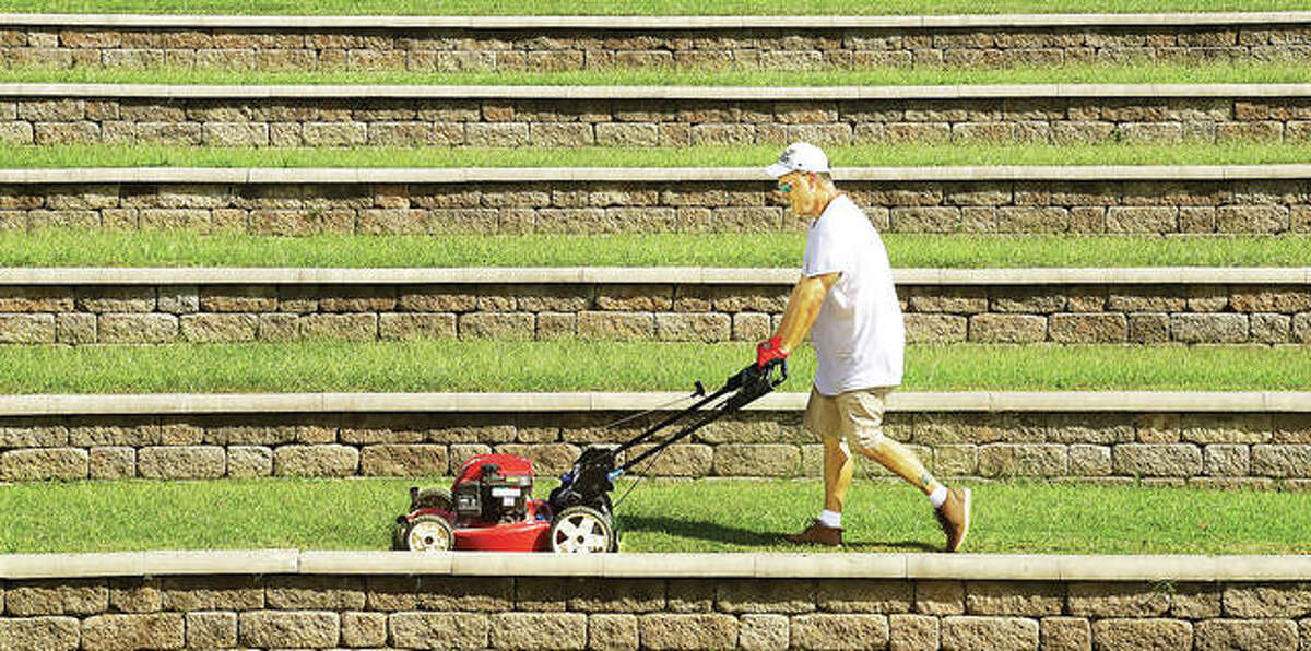 The Alton Parks and Recreation Department was mowing the multi-tiered area for seating Tuesday at the Alton Ampitheatre even though no events are scheduled there and Riverfront Park remains barricaded and closed as it has been all summer.