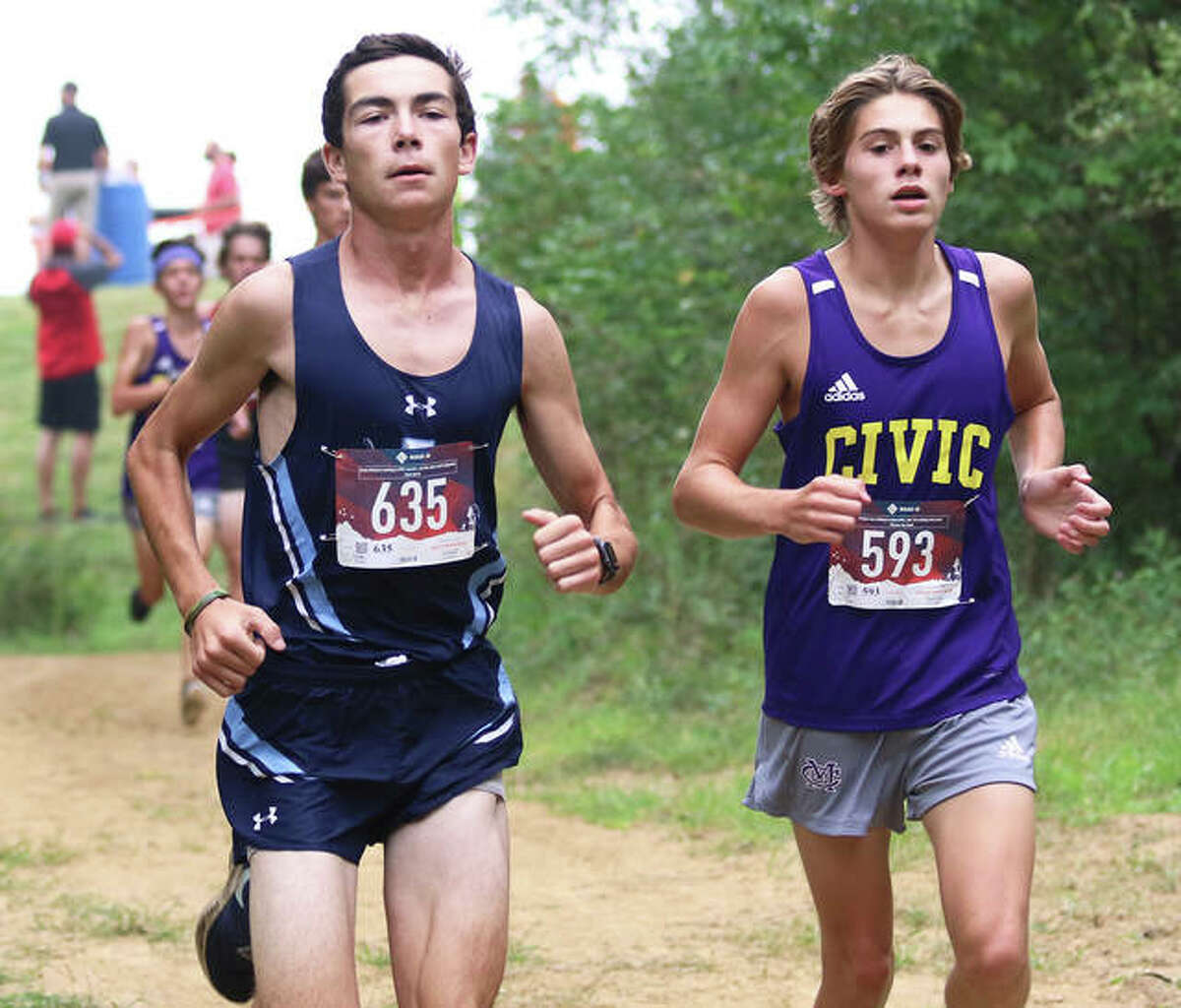 Jersey's Griffin Williams (left) and Civic Memorial's D.J. Dutton hit the loop through the woods on the Triad High School cross country course on Saturday morning at the Pre-MVC Meet in Troy. The host Knights won the boys division, with Waterloo winning the girls. Mascoutah did not compete in the meet.