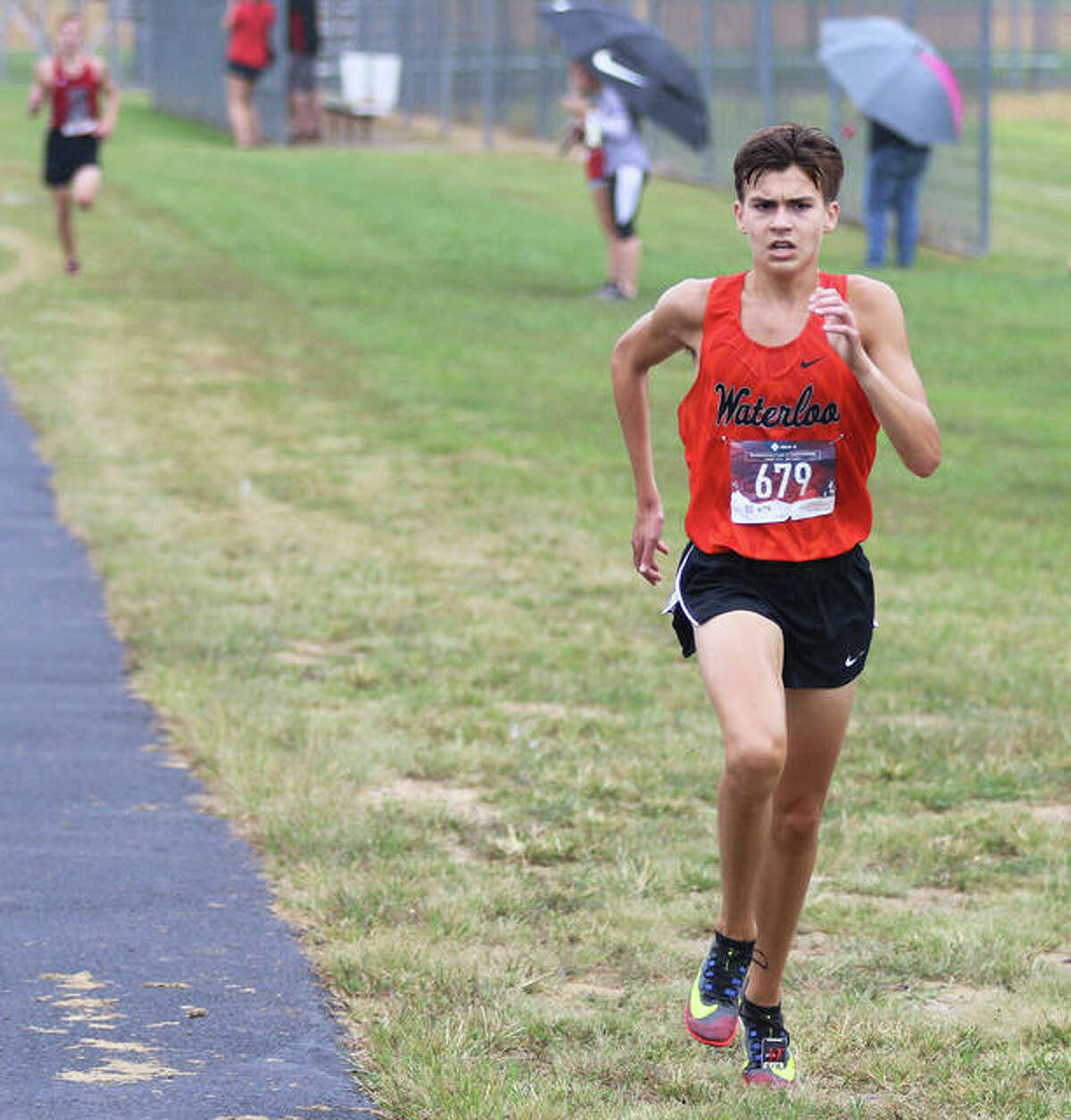 Waterloo sophomore Joe Schwartz approaches the track for the final quarter-mile of his victory in the Pre-MVC boys race.