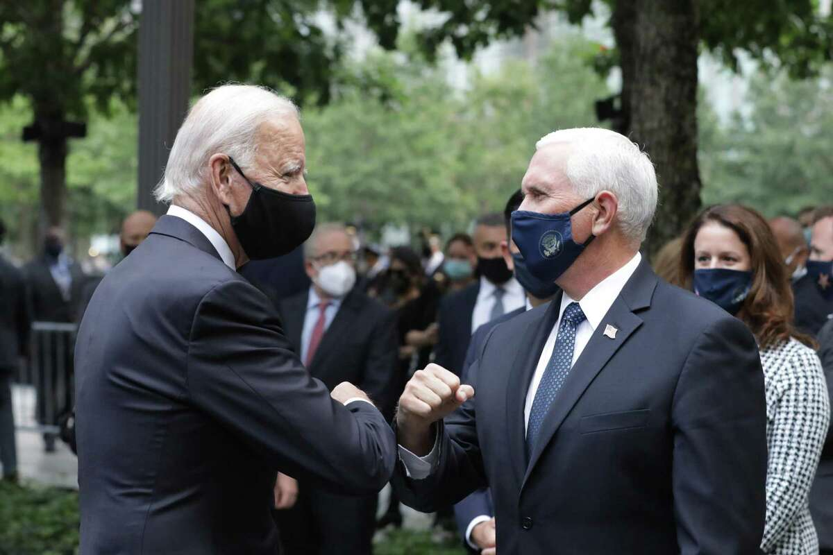 Democratic presidential nominee Joe Biden (L) and U.S. Vice President Mike Pence (R) greet each other during a 9/11 memorial service at the National September 11 Memorial and Museum on September 11, 2020 in New York City. The ceremony to remember those who were killed in the terror attacks 19 years ago will be altered this year in order to adhere to safety precautions around COVID-19 transmission. (Amr Alfiky - Pool/Getty Images/TNS)