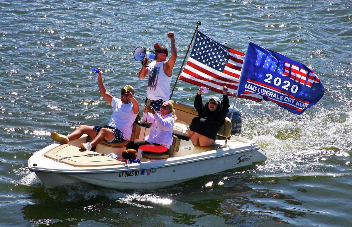 Supporters of President Trump take part in a boat parade on the Housatonic River in Stratford, Conn., on Saturday Sept. 12, 2020. The public Facebook event page titled