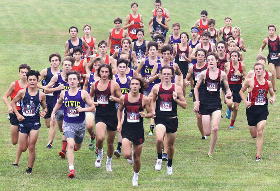 The Pre-MVC Meet boys field of 50 breaks from the start and heads for the first of two steep inclines of about 15 yards on Saturday morning at Triad High School in Troy. Photo: Greg Shashack / The Telegraph