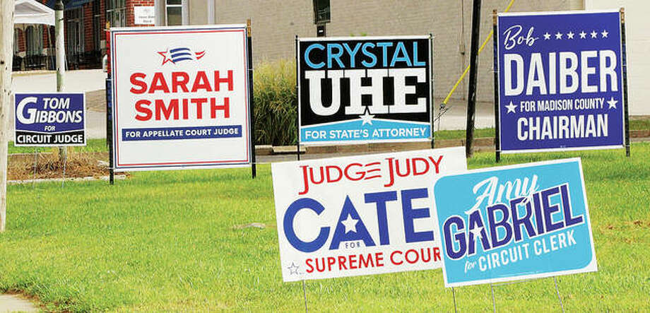 One of many grouping of election signs stands on Godfrey Road last week as the area gears up for the Nov. 3 election. Along with national, state and local races, Madison County voters will cast ballots on three countywide referendums and an amendment to the Illinois Constitution.