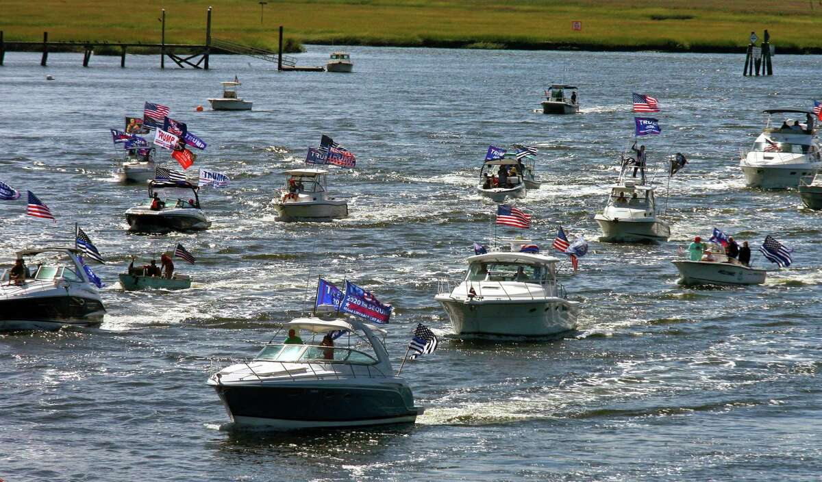 A boat parade of supporters of President Trump show their pride as they move towards the Devon Bridge on the Housatonic River in Stratford, Conn., on Saturday Sept. 12, 2020. The public Facebook event page titled