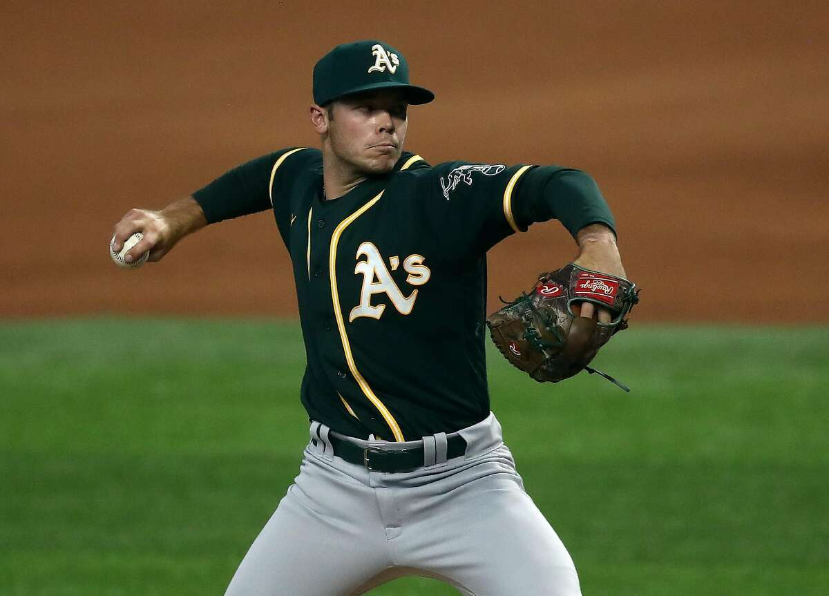 ARLINGTON, TEXAS - SEPTEMBER 12: Daulton Jefferies #66 of the Oakland Athletics throws in his major league debut against the Texas Rangers in the first inning at Globe Life Field on September 12, 2020 in Arlington, Texas. (Photo by Ronald Martinez/Getty Images)