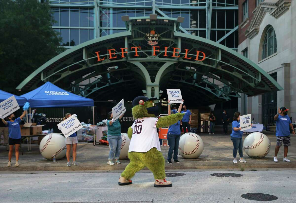 Houston Astros Mascot Orbit helps to direct the traffic during an emergency supplies drive for communities in the Lake Charles, La., area that were impacted by Hurricane Laura Saturday, Sept. 12, 2020, at Minute Maid Park in Houston.